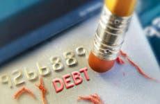 Erasing debt from credit card © iStock