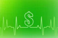 Dollar sign on green line chart © iStock