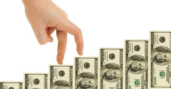 Fingers climbing money steps © iStock