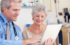 Doctor showing woman information on an iPad © iStock