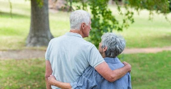 Senior couple embracing at a park © iStock