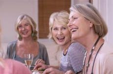 Women having dinner together, telling jokes | Monkey Business Images/Shutterstock.com