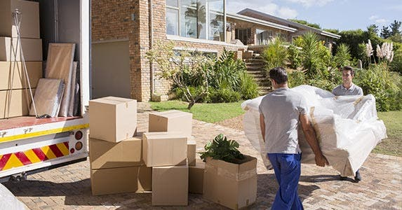 Money for moving expenses | CaiaImage/Getty Images