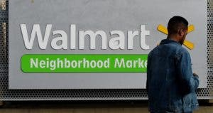 Young man in front of Walmart store | Getty/Mark Ralston