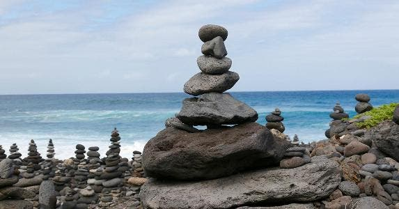 Rocks balancing on each other on the beach | Andreas Naumann / EyeEm/Getty Images