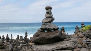 Rocks balancing on the beach | Andreas Naumann / EyeEm/Getty Images
