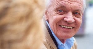 Close up shot of senior man smiling at companion © iStock