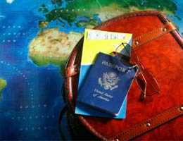 A passport, world map and travel bag