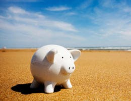 A piggy bank on the beach