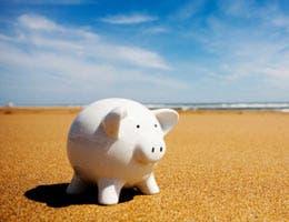 A piggy bank on the beach