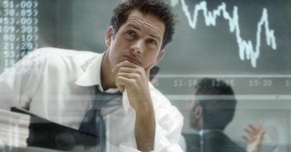 Investor analysing stock trends © iSTock