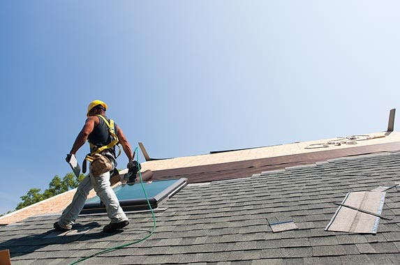 Roofers | Huntstock/Getty Images