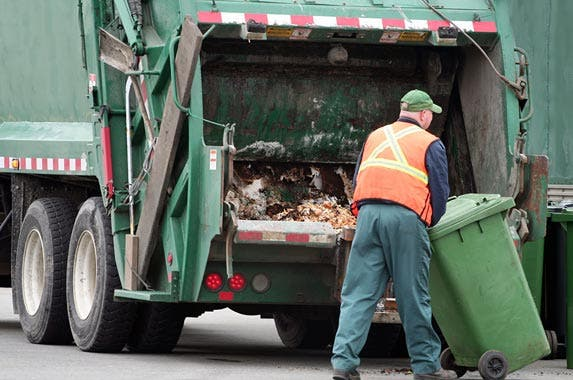 Refuse and recyclable material collectors | kozmoat98/Getty Images