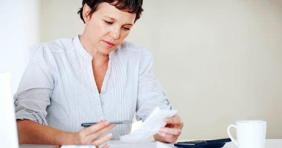Middle-aged woman going through receipts © iStock