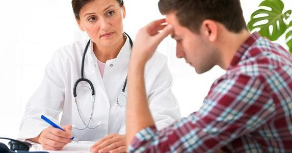 Doctor talking to male patient © Alexander Raths/Shutterstock.com