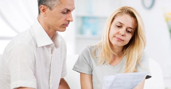 Couple looking at document | iStock.com