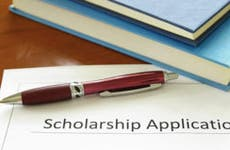 Pen and books on top of a scholarship application © zimmytws - Fotolia.com