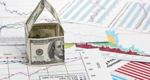 House of dollars on chart background © Nata-Lia/Shutterstock.com