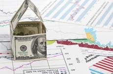 House of dollars on chart background © Nata-Lia/Shutterstock.com