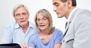 Mature couple with advisor reviewing documents © Robert Kneschke/Shutterstock.com