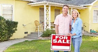 Couple standing in front of house © Monkey Business Images/Shutterstock.com