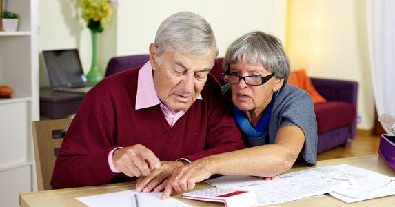 Seniors looking at paperwork © Federico Marsicano/Shutterstock.com