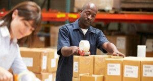 Two workers preparing shipment in warehouse   Monkey Business Images/Shutterstock.com