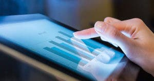 Woman holding digital tablet, closeup on graphs
