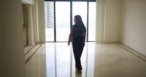 Woman checking high-rise condo | Joe Raedle/Getty Images