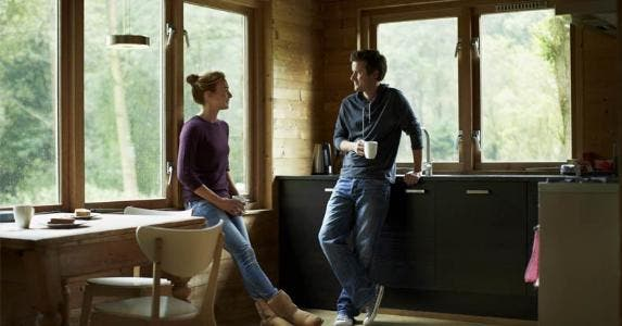 Couple relaxing in the kitchen   Morsa Images/DigitalVision/Getty Images