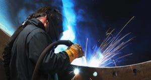Welder wearing protective gear | ChristopherFurlong/Getty Images