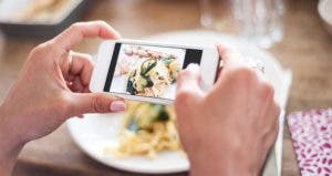 Taking picture of plated food | Lucia Lambriex/Getty Images