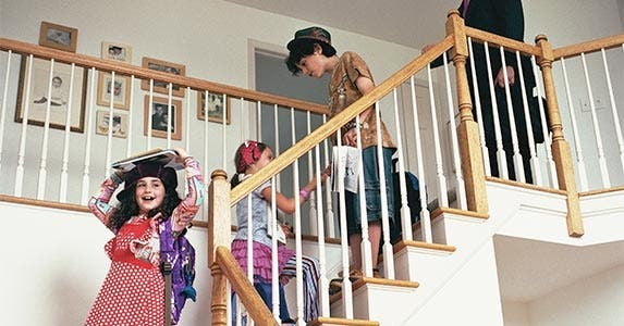 Family walking down the stairs in their home