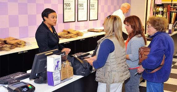 Store sales associate ringing up customers | Steve Jennings/Getty Images