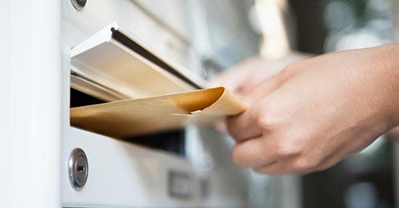 Send a letter to the reporting creditor | Andrey_Popov/Shutterstock.com