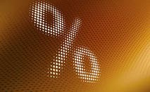 Percent sign, yellow-brown background   Ralf Hiemisch/Getty Images