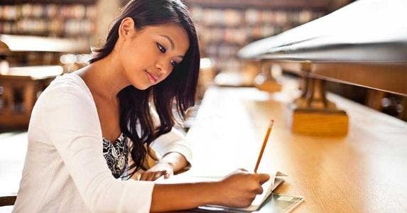 Young woman studying in library © arek_malang/Shutterstock.com