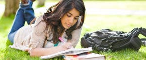 Young woman studying on grass © arek_malang/Shutterstock.com