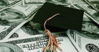 Graduation cap on $100 bills © zimmytws/Shutterstock.com