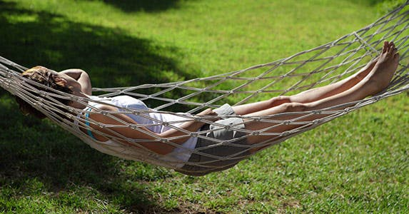 Woman lying on hammock