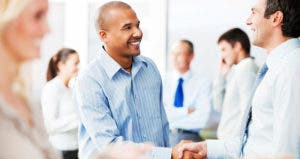 Two businessmen shaking hands © iStock