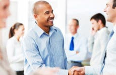 Two businessmen shaking hands © iStock