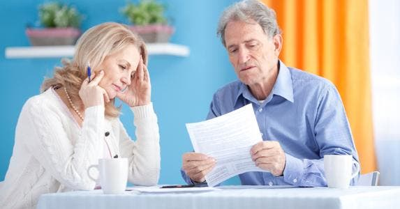 Senior couple looking over budget, bills © iStock