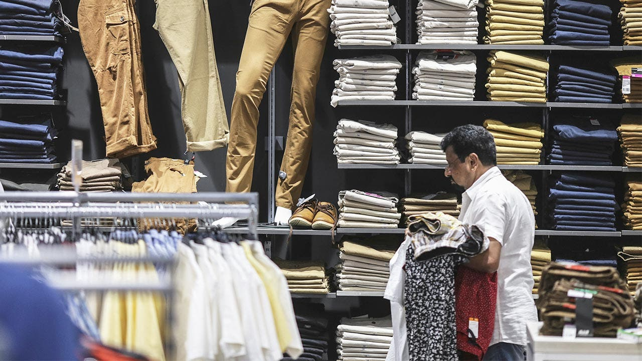 Man shopping for pants at a retail store