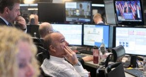 Stock brokers watch presidential election    Thomas Lohnes/Getty Images