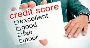 Male holding credit score card © iStock