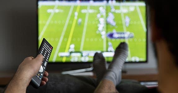 Big-screen TVs | iStock.com/TARIK KIZILKAYA