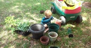 Little boy playing with pots in the garden | Photo courtesy of Alicia Brown