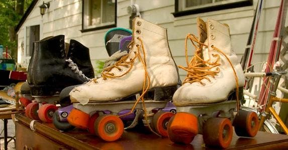 Roller skates in garage sale | iStock.com/tillsonburg