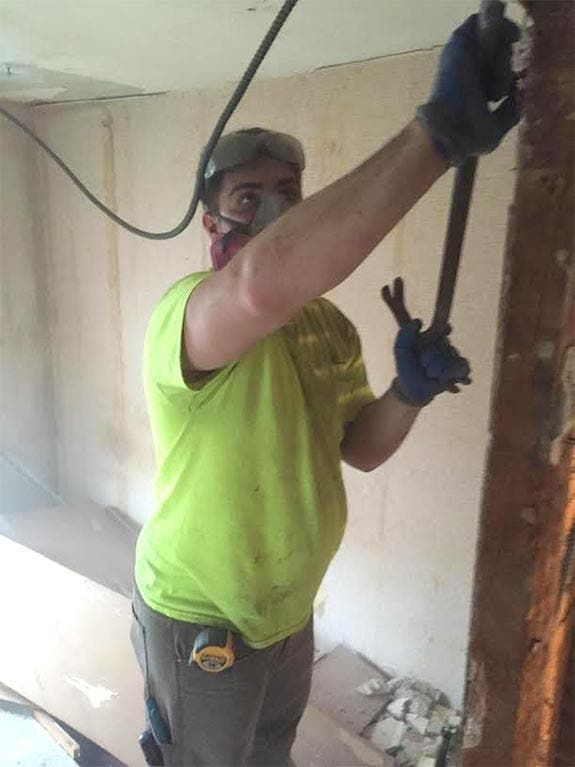 Michael Zonin completes demo work on a house | Photo courtesy of Marc Aschoff
